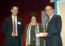 Loyd Grossman present the winning prize to Brian Lavoie and Rebecca Guenther, representing the PREMIS team
